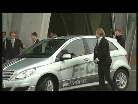 Michael Schumacher and Nico Rosberg driving  Mercedes Benz B-Class F-Cell