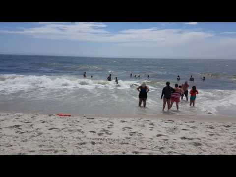 Long Island, NY: Robert Moses Beach Lifeguards Rescue Swimmers Caught in Strong Ocean Currents