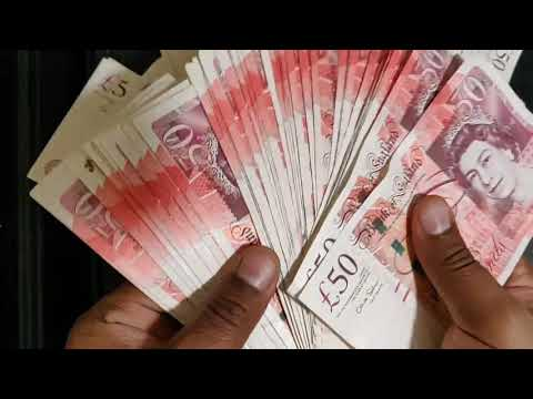 Counting out brand new £50 notes | Visualize British money
