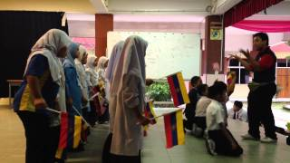 Primary school kids excited performing patriotic song celebrating National Day Malaysia
