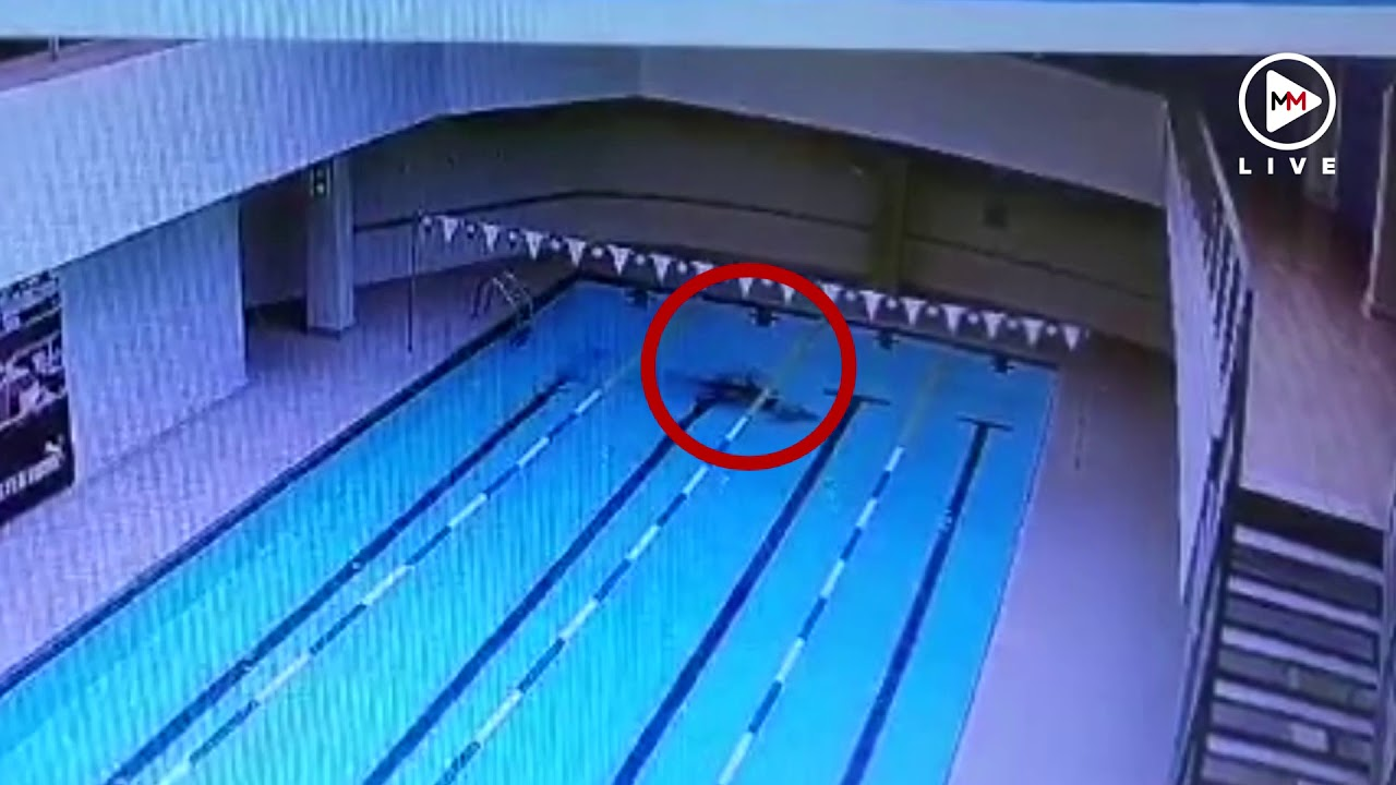 Man has medical event during lap swim.  Watch how fast it happens.