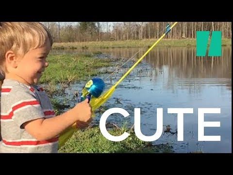 Little boy catches fish with toy rod youtube for Kids fishing poles