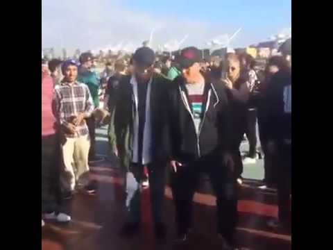 Two guys throw down at festival.. This is amazing