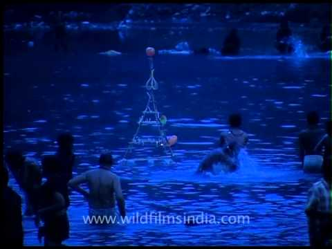 Devotees taking holy dip in River Pampa