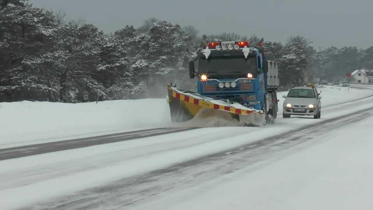 Volvo truck snow plow and scrape ice from the road in 2013 ...