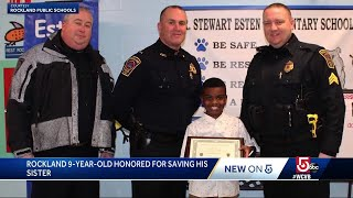 Boy honored by first responders for helping save his sister