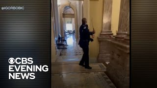 Officer hailed as a hero for leading Capitol rioters away from lawmakers