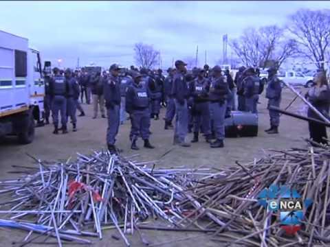 eNCA | Police Raid Miners' Hostels