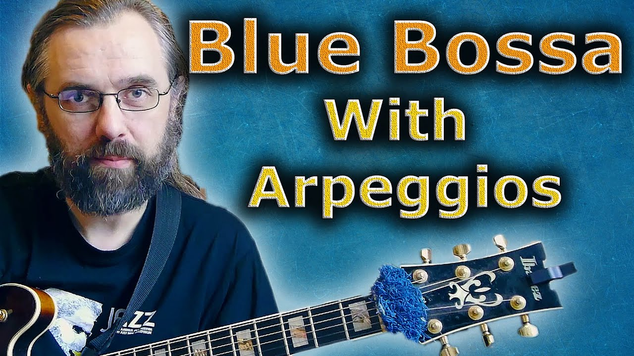 watch blue bossa soloing with arppeggios jazz guitar lesson