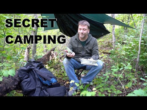 Urban Stealth Camping With Hammock In Residential Area