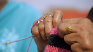 Closeup of an Indian woman knitting wool with knitting needles -  Woman's lifestyle concept
