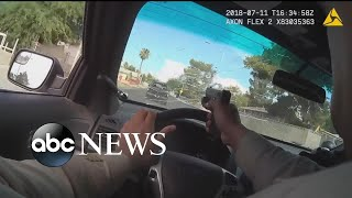 Police bodycam shows officer firing through windshield during chase
