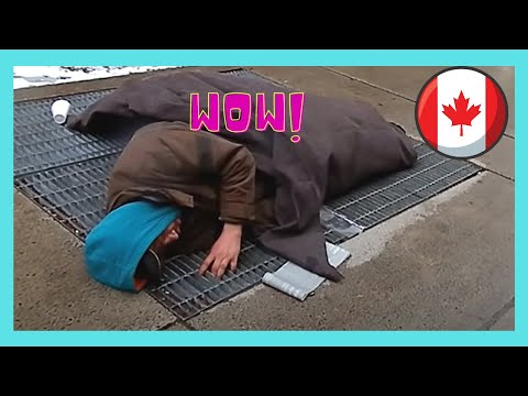 Homeless person sleeping on a vent, Toronto, Canada