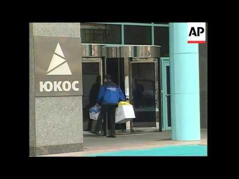 Court upholds freezing of Yukos accounts, new raid