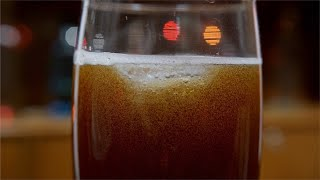 Shot of bubbles in glass filled with cola soda