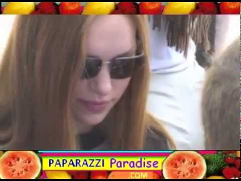 LAURA PREPON and boyfriend CHRIS MASTERSON hold hands leaving carnival  2001