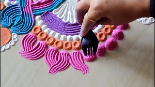 Super easy rangoli using fork and used colours l Rangoli designs with colours l रंगोली डिजाइन