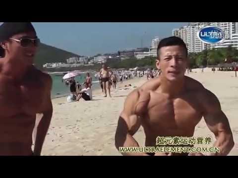 Bodybuilders on beach