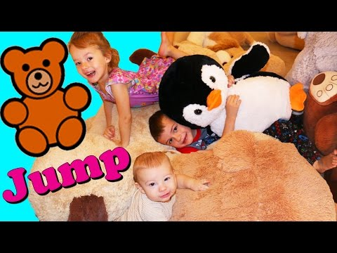 GIANT TEDDY BEAR JUMP!!! World's Biggest Dog & Bear Plush Family Fun Game DisneyCarToys Kids