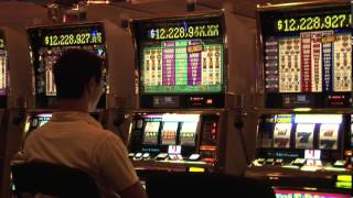 Megabucks Slot Machine in Las Vegas Casino with a Player Pulling Lever Trying for a Winning Jackpot