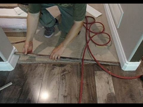 Laminate floor transition to carpet how to install for How to replace hardwood floor strips
