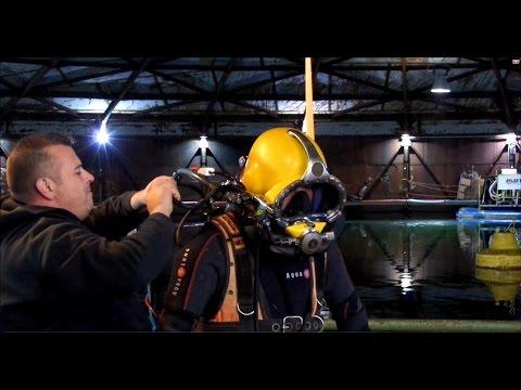 Kirby Morgan helmet diving in a gas holder
