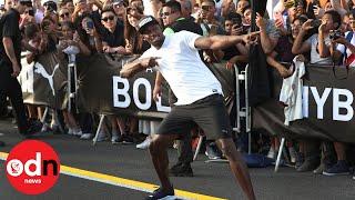"""بالفيديو: أسرع رجل في العالم يتسابق مع """"توك توك"""""""