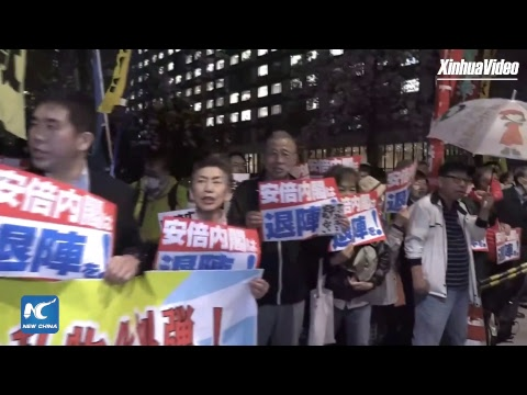 Japanese protesters demand Shinzo Abe step down over scandal