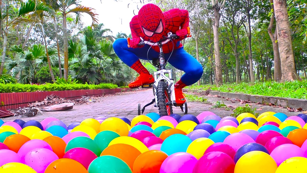 Spiderman VS Princess Anna crushes Joker's water balloons under bike! Funny spiderman Video