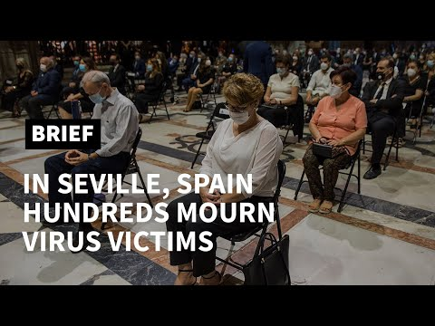 Hundreds mourn the dead at Seville mass for virus victims | AFP