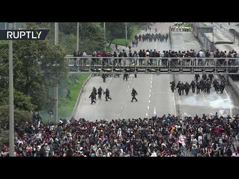 Scuffles erupt as 15,000 students shut down Bogota highway