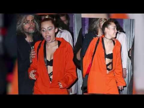 Miley Cyrus Flaunts Her Bra In Inmate Orange Jumpsuit | Splash News TV | Splash News TV