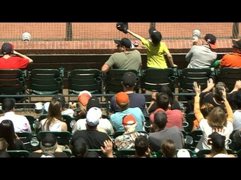 Boy snags foul ball with glove to save dad