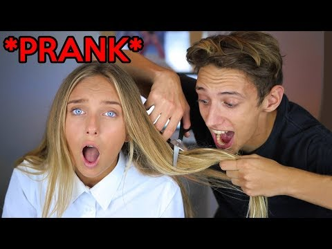 CUTTING MY LITTLE SISTERS HAIR *PRANK* (SHE FREAKED OUT)