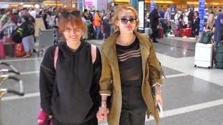 Bella Thorne Holds Hands With Sister Jetting Out Of LAX