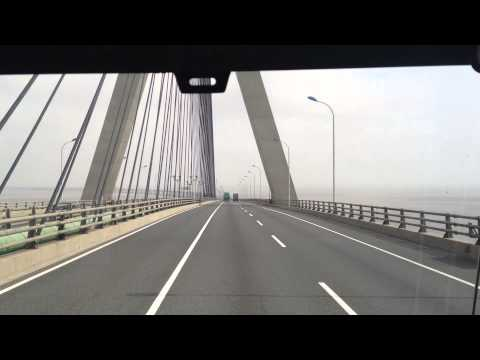 Riding along an ocean bridge of 32 km to Yangshan Port, Shanghai