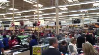 Flash mob caroling at Kroger grocery store.