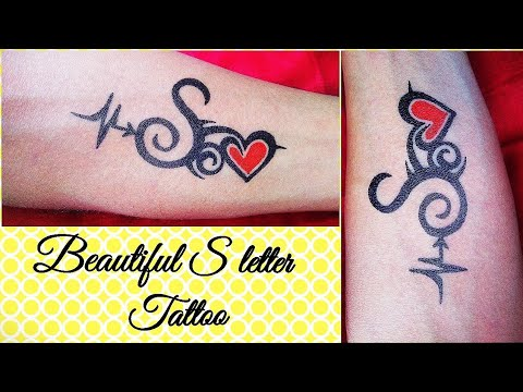 Simple And Beautiful S Letter Tattoo With Heart