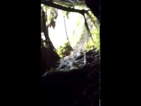 Tunnel through a relaxing waterfall in Jardín, Antioquia Colombia