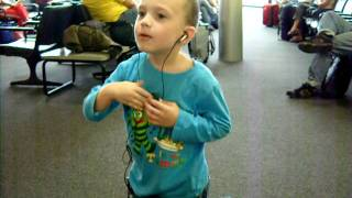 "cute 4 year old boy singing Taylor Swifts ""love story"" in clwr airport"