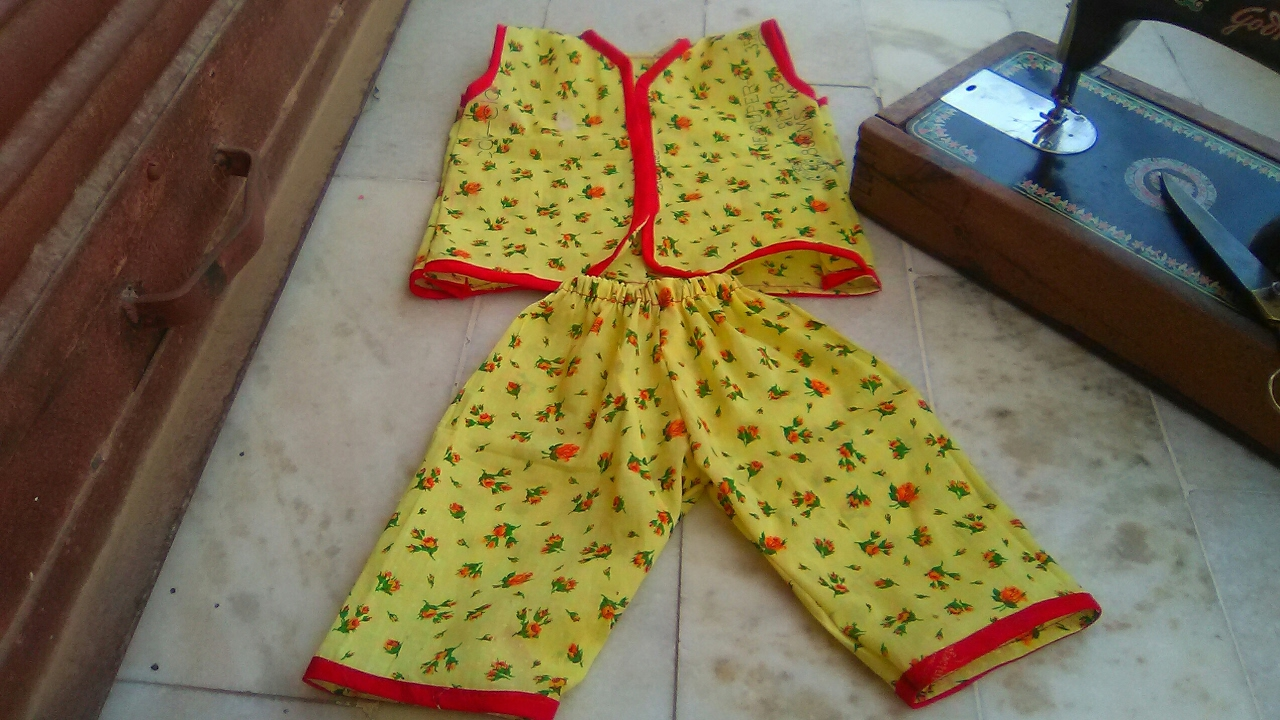 6d09050fd807 a baby jabla with long nikar with piping Patti with measurement ...