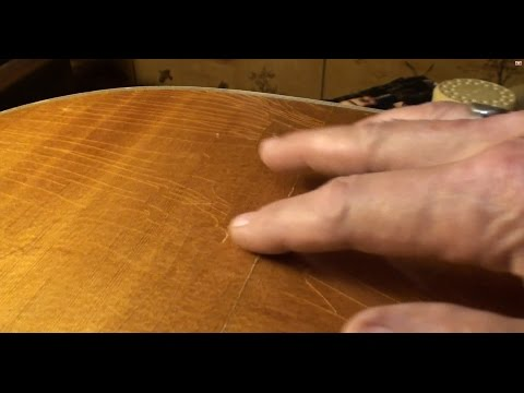 Acoustic guitar cracked top repair by Randy Schartiger