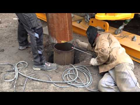 Installing  surface casing for a well head