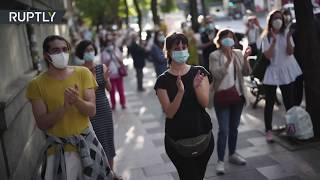 COVID-19 backlash   Spanish health workers protest against lack of PPE & staff
