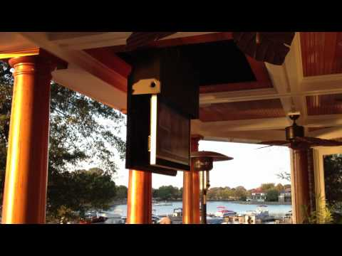 Custom Motorized TV On Lake Side Patio By Freeman's Stereo Video- Home Division