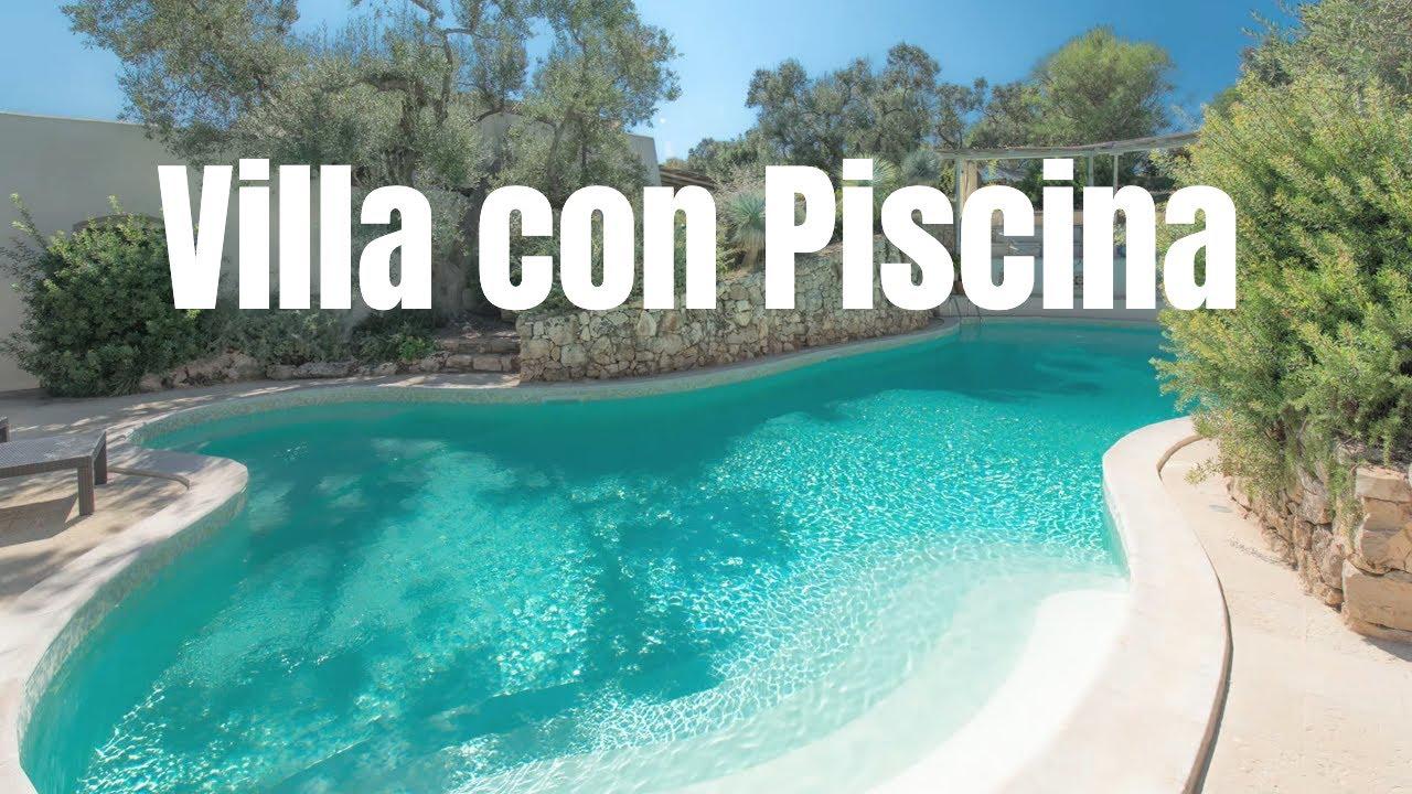 Villetta con piscina immersa nel verde 102 ville con for Ville moderne con piscina