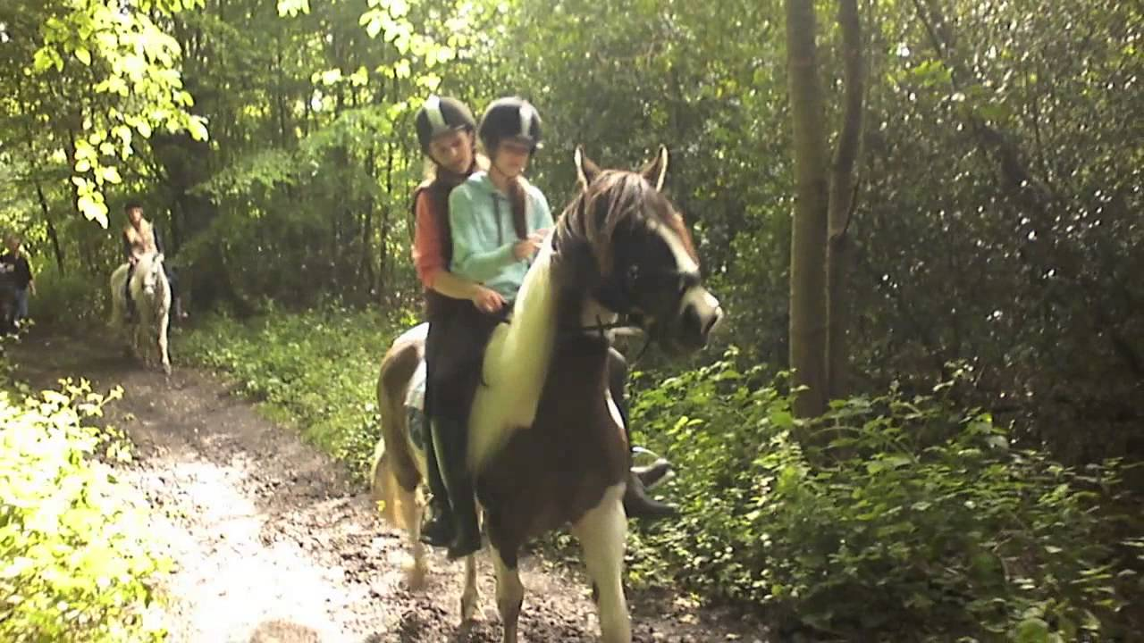 Two Girls Riding One Horse