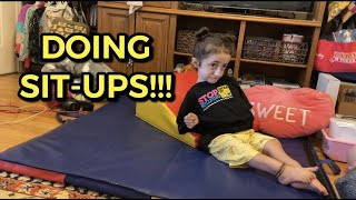 Sammi Haney Doing Sit-Ups at Home with CRIT-USA
