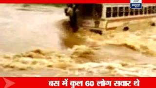 Bus washed away by swollen river, three dead