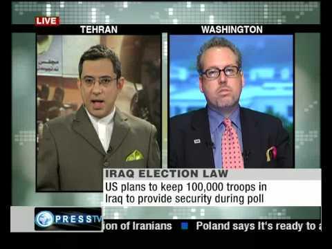 Press TV's Arash Zahedi talks to Paul Kawika Marti...